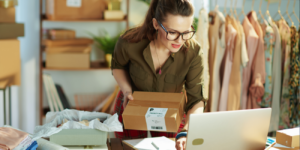 o Female business owner shipping orders to customers.